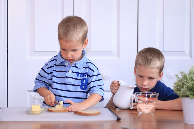 children learn spreading and pouring kitchen skills
