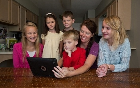 family watching online cooking videos for kids