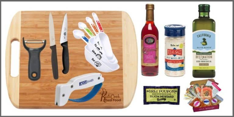 Everything needed to teach class 1 of Kids Cook Real Food: paring knife, measuring cups/spoons, peeler, bamboo cutting board, Real Salt, red wine vinegar, olive oil, knife sharpener, Dijon mustard, spices