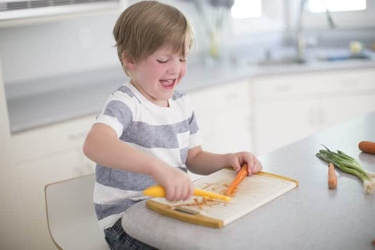 Kids learn to cook by peeling a carrot
