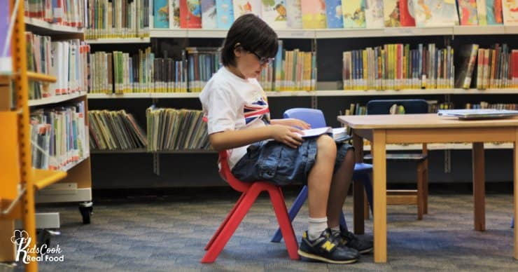 Child sitting in a chair reading