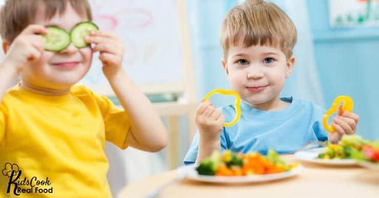 Boys eating vegetables